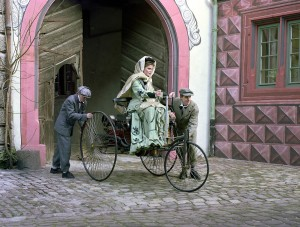 Bertha Benz with her sons Eugen and Richard during the long-distance journey from Mannheim to Pforzheim with the Benz Patent Motor Car in 1888. Reconstructed scene (push-starting the car) on celebrating the 100th anniversary of the motor vehicle's first long-distance journey.