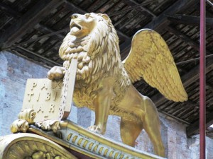 The winged lion of Venice on the bow of the royal barge.