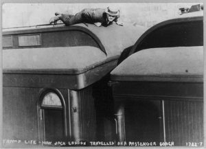 Hobo riding atop a box car.
